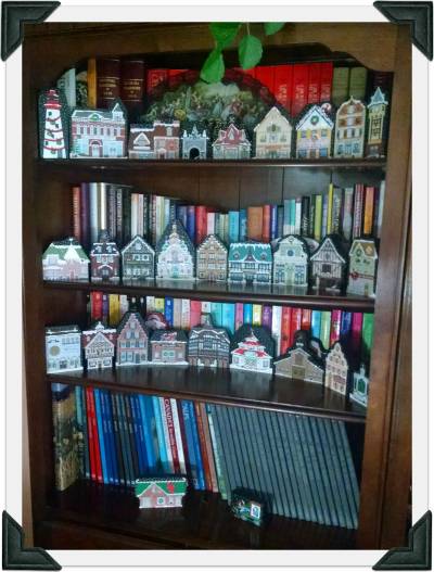A bookcase in Chris' home decorated with Christmas Cat's Meows