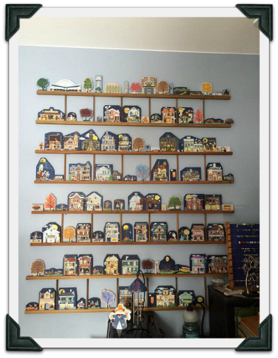 Gail fills a wall with ladders to show off her Cat's Meow Halloween collection.