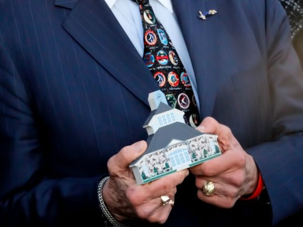 Buzz Aldrin holding his very own Cat's Meow replica of the Germanna Foundation