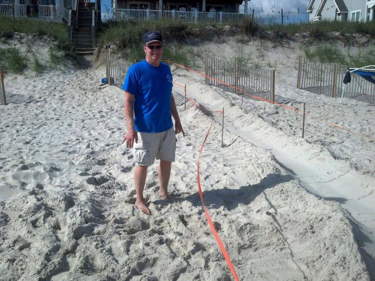 Volunteers help build ramps from sea turtle nests to the ocean so the babies have a better chance at making it to the ocean.