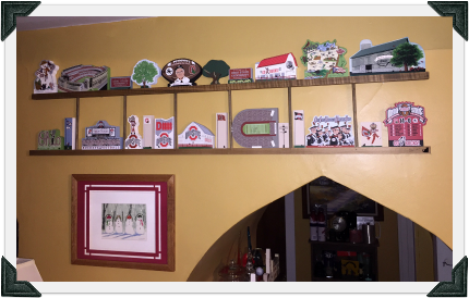 Tony's Ohio State Cat's Meow Collection displayed on Cat's Meow ladders in his home.