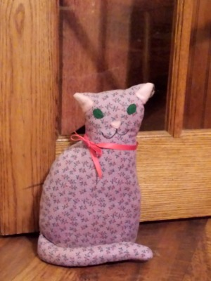 Photo of the first calico cat doorstop Faline crafted in the late 1970's.