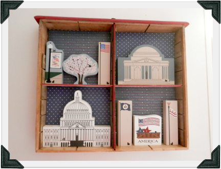 Annette upcycled a vintage cupboard drawer to display her Washington D.C. Cat's Meow collection in