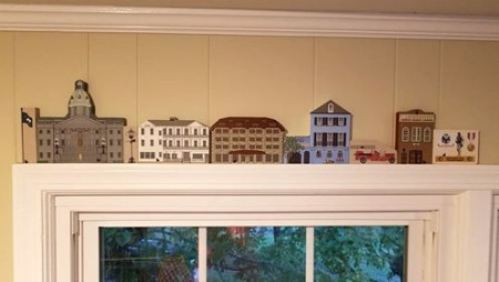 Deonna's Cat's Meow collection perched on the trim above her window, reflects the important moments in her life.