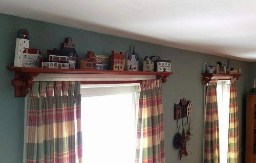 Mandie purchased quilt shelves to put above her windows to display her Cat's Meows