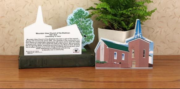 Example of a church re-created in a wooden keepsake by The Cat's Meow Village