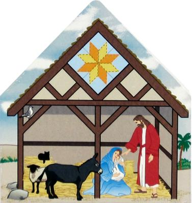Handcrafted wooden shelf sitter of a Nativity Family featuring a Star Of Bethlehem quilt pattern created by The Cat's Meow Village