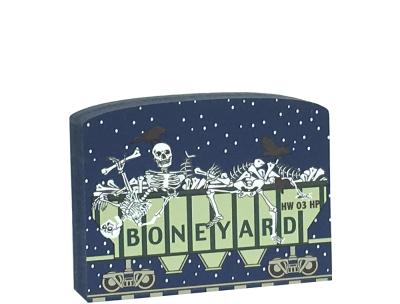 "This Boneyard train car is part of a 5-piece Halloween train set. Handcrafted by The Cat's Meow Village in Wooster, Ohio from ¾"" thick wood to set on a bookshelf, mantel, windowsill, or the trim above your doorway."