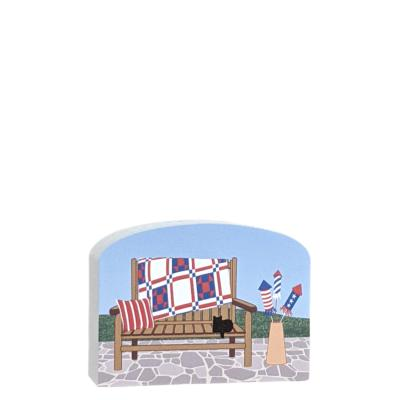 Patriotic Quilt Bench inviting you to sit and relax for awhile. Handcrafted in the USA by The Cat's Meow Village.