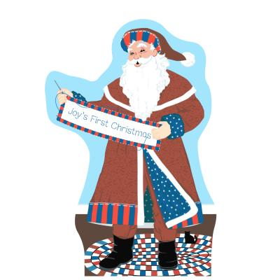 """Santa will stitch your holiday message on his quilt banner. Handcrafted in 3/4"""" thick wood by The Cat's Meow Village in Wooster, Ohio."""