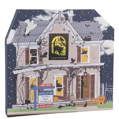 """Are you in the market for a haunted house? The ghouls are ready to sell. It has a bootiful interior! Handcrafted of 3/4"""" thick wood by The Cat's Meow Village in Wooster, Ohio."""