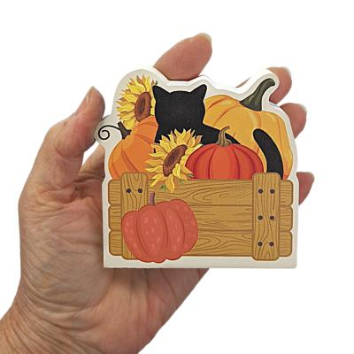 """Wouldn't this cute fall cat and pumpkins look cute on your workdesk or bookshelf? We handcraft it in 3/4"""" thick wood in Wooster, Ohio."""