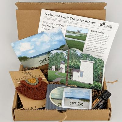 This Cape Cod National Seashore box includes a replica of the Three Sisters Lighthouses along with a macrame car charm and a bottle of DoTERRA Wild Orange essential oil.