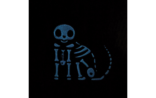 """This is Skelocat Casper with all his bones glowing in the dark when the lights are turned out. Handcrafted of 3/4"""" thick wood in Wooster, Ohio by The Cat's Meow Village."""