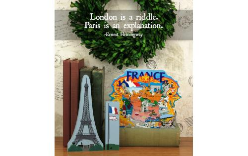 Home display of the Eiffel Tower and Map Of France souvenirs handcrafted from wood by The Cat's Meow Village
