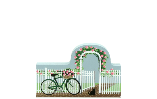 Rose trellis fence with bike and open gate invites you in. Handcrafted in wood by The Cat's Meow Village