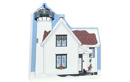 "Decorate a niche in your home with this West Chop Lighthouse, part of the Martha's Vineyard Christmas Series handcrafted in 3/4"" thick wood by The Cat's Meow Village"