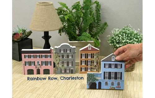 Just a few of the Rainbow Row house replicas lining Bay Street in Charleston, SC. Now create you own miniature version of the most photographed street in American. Crafted by The Cat's Meow Village in the USA.