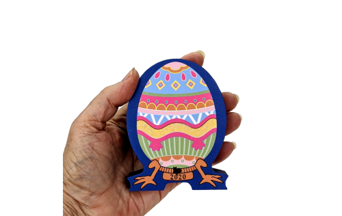 """This beautifully colored keepsake, Furbergé Egg Pink Paws 2020 is handcrafted in ¾"""" thick wood for you by The Cat's Meow Village."""