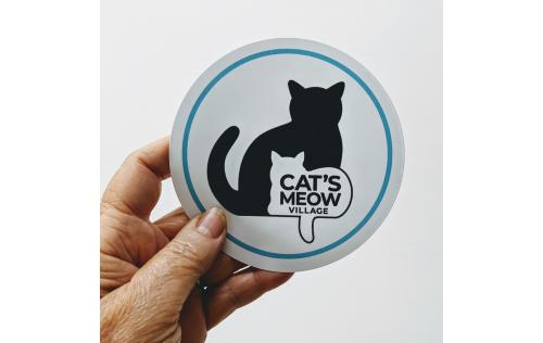 "4"" Vinyl sticker of Cat's Meow Village logo with teal edge"