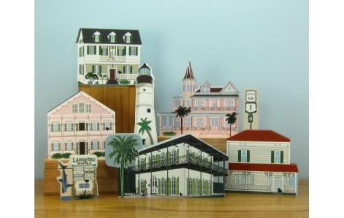 Grouping of Key West buildings including the Hemingway Home & Museum handcrafted in wood by The Cat's Meow Village