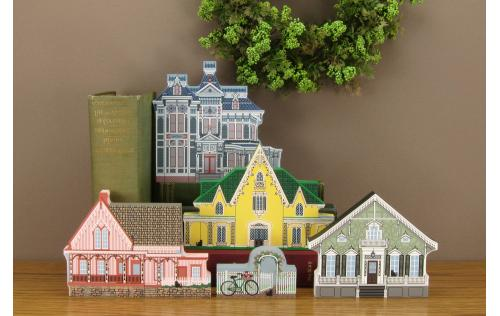 Example of the Cat's Meow Village Victorian homes grouped together on a table