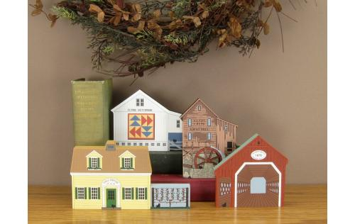 Example of the Cat's Meow Village buildings grouped together on a table