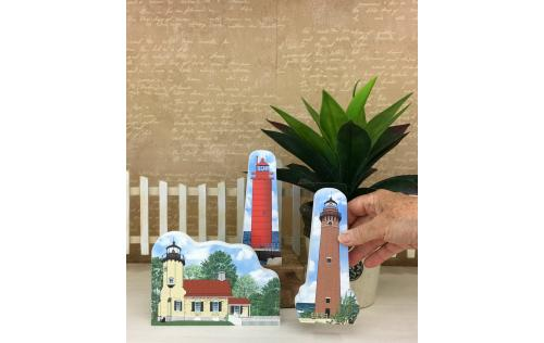 Muskegon, White River and Little Sable Point lighthouses shown together as an example of how you can display them in your home. Handcrafted in the USA by The Cat's Meow Village.