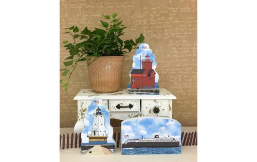 Ludington and Big Red lighthouses shown together with the SS Badger steamship as an example of how you can display them in your home. Handcrafted in the USA by The Cat's Meow Village.