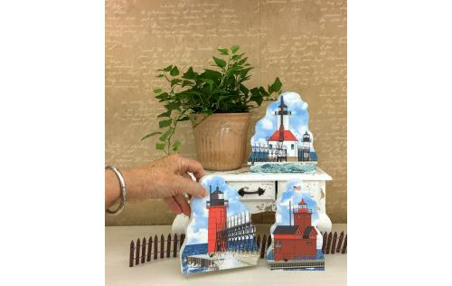 St. Joseph North Pier, Big Red, and South Haven lighthouses shown together as an example of how you can display them in your home. Handcrafted in the USA by The Cat's Meow Village.