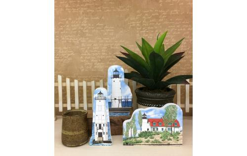 Manistee North Pierhead, Frankfort North Breakwater and Point Betsie lighthouses shown together as an example of how you can display them in your home. Handcrafted in the USA by The Cat's Meow Village.