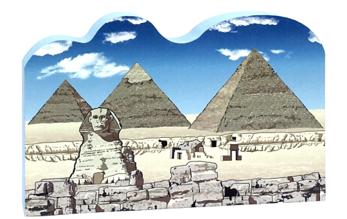 This wooden replica of the Great Pyramids in Giza, Egypt, was handcrafted by The Cat's Meow Village and made in the USA.