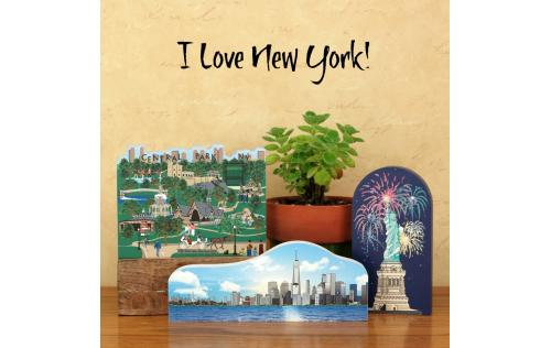 "New York City Skyline displayed with Central Park and the Statue Of Liberty, all handcrafted of 3/4"" thick wood by The Cat's Meow Village"
