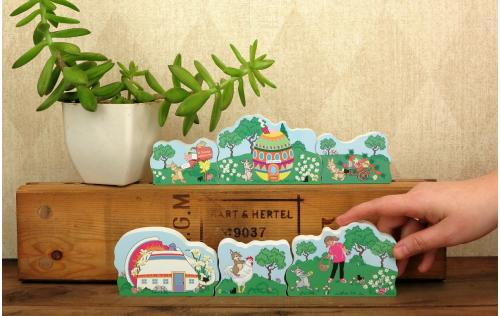 Eliza is shown with all the other Cottontail Path Collection. When set together they create a charming Easter scene.