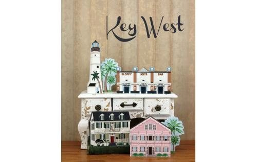 Grouping of Key West buildings including the Pink House handcrafted in wood by The Cat's Meow Village