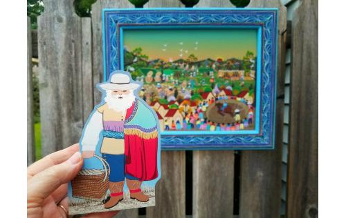 Colonial Mexico Santa shown with the painting from Mexico that inspired Faline for his design.