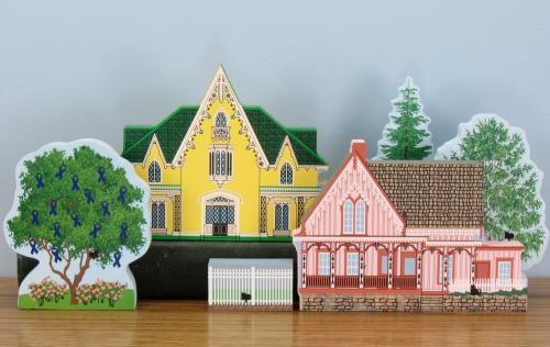 Example of Cat's Meow Village houses displayed with the 2014 Cystic Fibrosis Tree