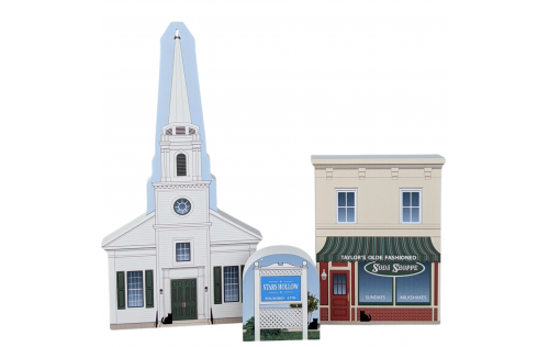 Gilmore Girls scene including Stars Hollow Church, Taylor's Soda Shoppe and the town sign. handcrafted by The Cat's Meow Village in Wooster, Ohio.
