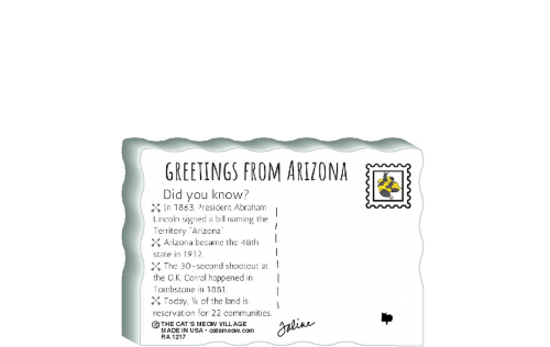 "This is the back of our 3/4"" thick postcard style Arizona flag. It includes a greetings and facts about Arizona. Crafted by The Cat's Meow Village in the USA!"