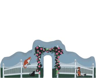 Home display of the Welcome Home Fence handcrafted from wood by The Cat's Meow Village