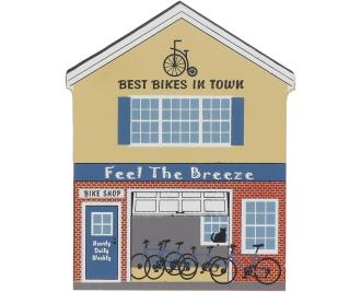 Decorate your home with a little wooden Village that reminds you of Feel the Breeze Bike Shop. Handcrafted in wood by The Cat's Meow Village.