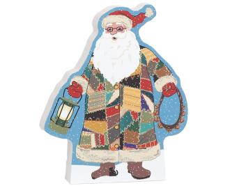 "Handcrafted Quilted Santa ready to add to your holiday decor. Crafted in 3/4"" thick wood by The Cat's Meow Village"