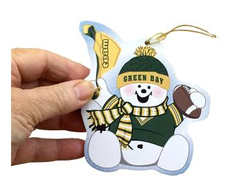"Waving his team spirit towel and cheering on his team, Green Bay, this snowman is handcrafted of 1/4"" thick wood by The Cat's Meow Village in the USA."