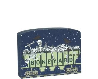 """This Boneyard train car is part of a 5-piece Halloween train set. Handcrafted by The Cat's Meow Village in Wooster, Ohio from ¾"""" thick wood to set on a bookshelf, mantel, windowsill, or the trim above your doorway."""