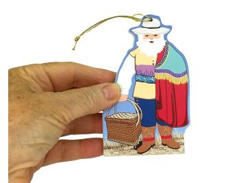 "This Colonial Mexico Santa will add lots of color to your Christmas tree. Handcrafted from 1/4"" thick wood by The Cat's Meow Village in the USA."