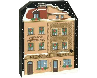 """Satisfy your Christmas holiday decorating itch with this Nicholas Library, and while you're at it, add more pieces to make a Village! Handcrafted of 3/4"""" thick wood by The Cat's Meow Village in the USA."""