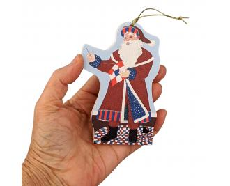 This Red, White & Blue Santa ornament celebrates quilting and American veterans! Handcrafted by The Cat's Meow Village in Wooster, Ohio.