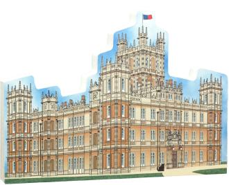 "The handcrafted wooden replica of Highclere Castle near Newbury, England, was inspired by the television series ""Downton Abbey."" Created by the Cat's Meow Village and made in the USA."