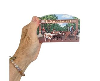Wooden replica of the Fort Worth Herd Cattle Drive that happens daily in Fort Worth, Texas. Handcrafted by The Cat's Meow Village in the USA.