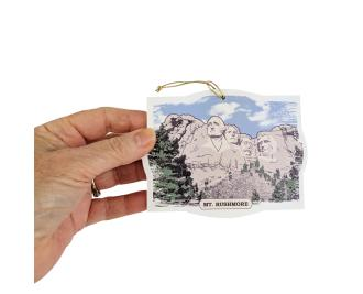 Wooden ornament of Mount Rushmore handcrafted by The Cat's Meow Village in the USA